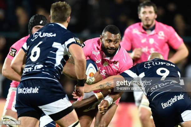 Stade Francais's Waisea Vuidravuwalu runs with the ball during the French Top 14 rugby union match between SU Agen and Stade Francais on November 25...
