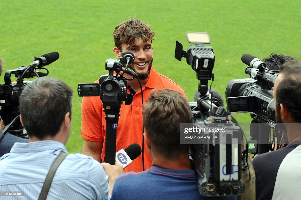 Stade Toulousain rugby club's French fullback Alexis Palisson speaks to the press on the steps of a training session on July 1, 2014 at the Ernest Wallon stadium in Toulouse,southwestern France.