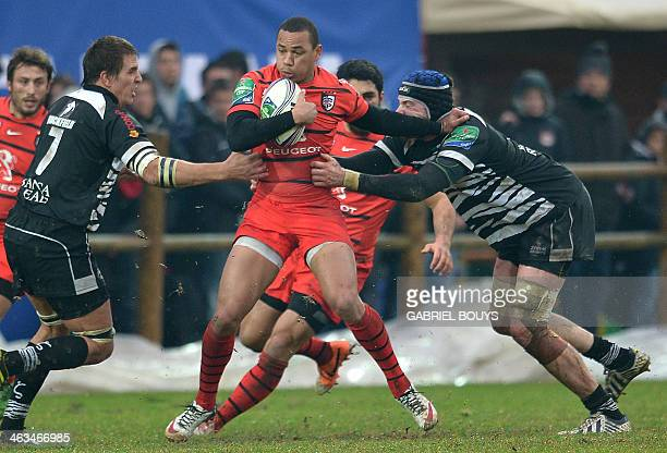 Stade Toulousain's centre Gael Fickou is tackled by Zebre's flanker Andries Van Schalkwyk and Zebre's lock Quintin Geldenhuys during the European Cup...