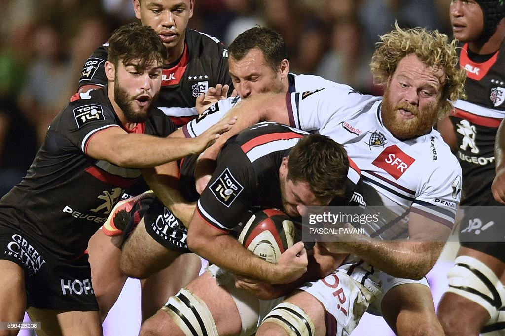 Stade Toulousain's French scrumhalf JeanMarc Doussain collapses with BordeauxBegles' French hooker Ronan Chambord during the French Top 14 Rugby...