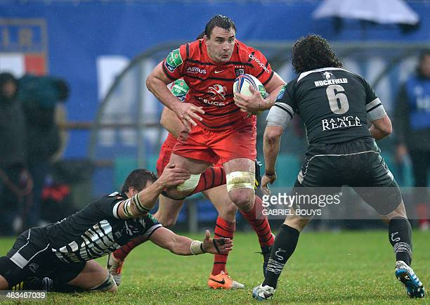 Stade Toulousain's N°8 Louis Picamoles outpasses Zebre's flankers Andries Van Schalkwyk and Mauro Bergamasco during the European Cup rugby union...