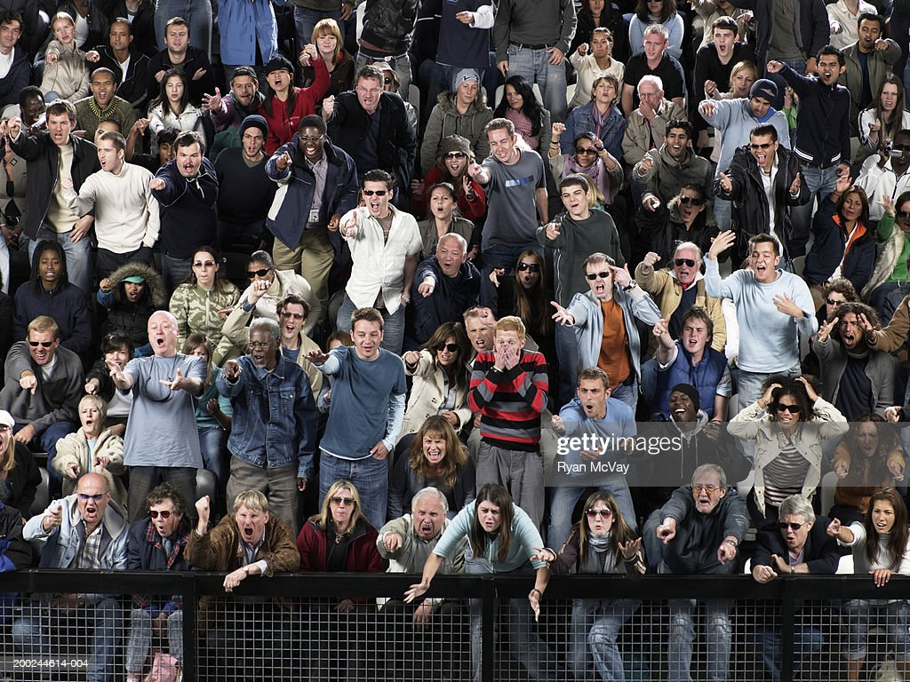 Stadium crowd pointing and shouting in same direction, full frame : Stock Photo