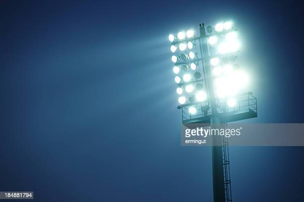Stadium lights against dark blue sky  - front view