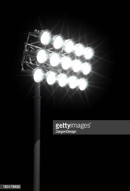 Stadium lights aimed down at the football field