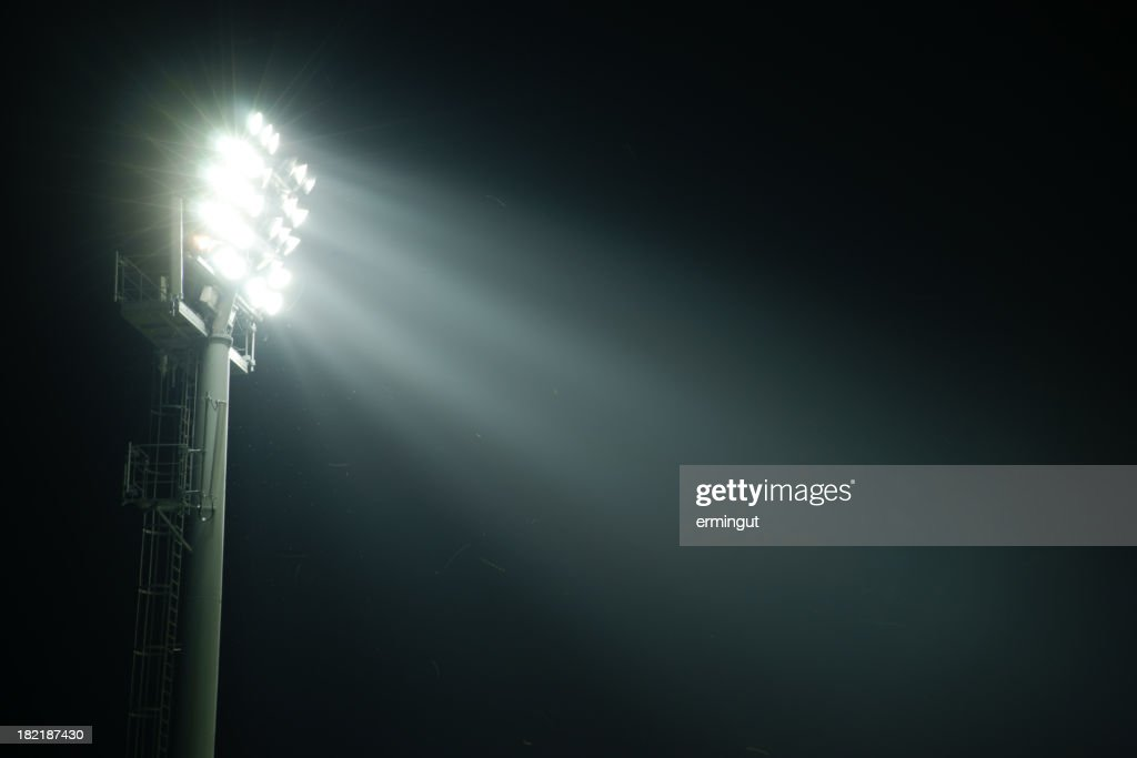 A stadium lights at night from the side : Stock Photo