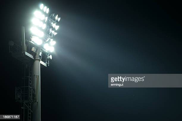 Stadium lights from side with light beams