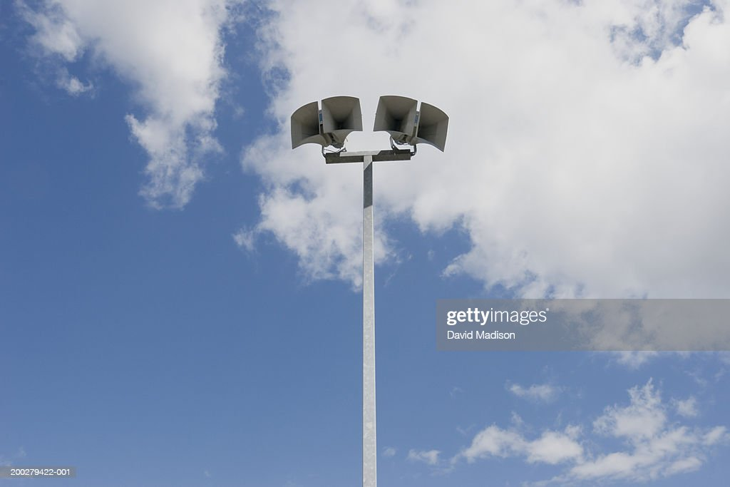 Stadium loudspeaker against sky and clouds