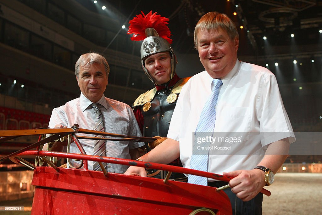 Stadium manager Ruediger Mengelde of the Veltins Arena, a quadriga rider and president Josef Schnusenberg of Schalke pose during the Ben Hur live show presentation at the ISS Dome on August 6, 2009 in Duesseldorf, Germany.