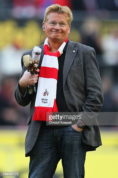 Stadium speaker Michael Trippel of Cologne looks thoughtful after announcing the postponed match at RheinEnergieStadion on November 19 2011 in...