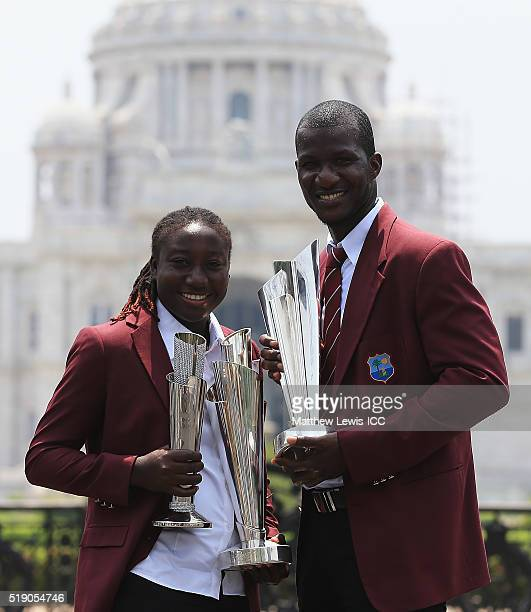 Stafanie Taylor Captain of the West Indies and Darren Sammy Captain of the West Indies pose with the trophies during a photocall after winning the...