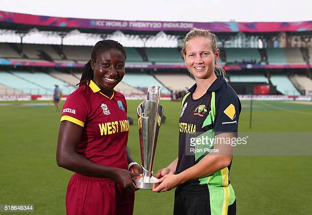 Stafanie Taylor Captain of the West Indies and Meg Lanning Captain of Australia pose with the Trophy during previews ahead of the Women's ICC World...