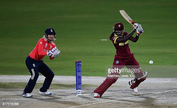Stafanie Taylor Captain of the West Indies hits the bal towards the boundary as Sarah Taylor of England looks on during the Women's ICC World...