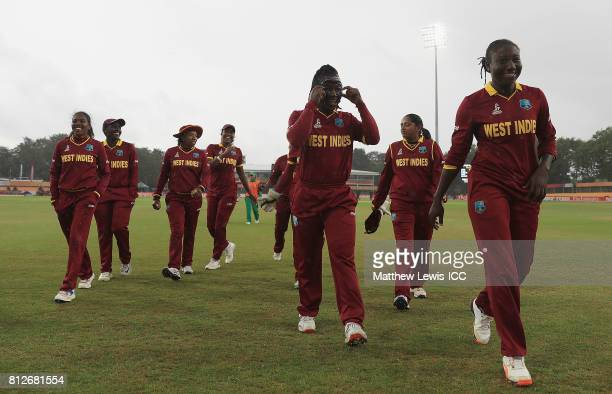 Stafanie Taylor Captain of the West Indies leads her team off the field of play after rain stops play during the ICC Women's World Cup 2017 match...