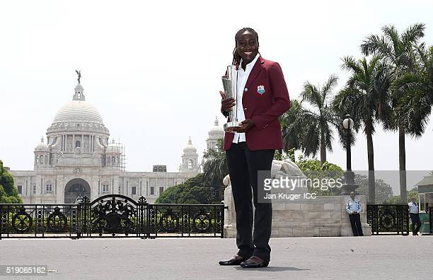 Stafanie Taylor Captain of the West Indies poses with the trophy during a photocall after winning the Final of the ICC Women's World Twenty20 at the...