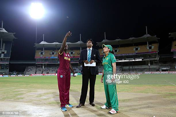 Stafanie Taylor Captain of the West Indies toss the coin with match official Javagal Srinath and Sana Mir Captain of Pakistan looking on during the...