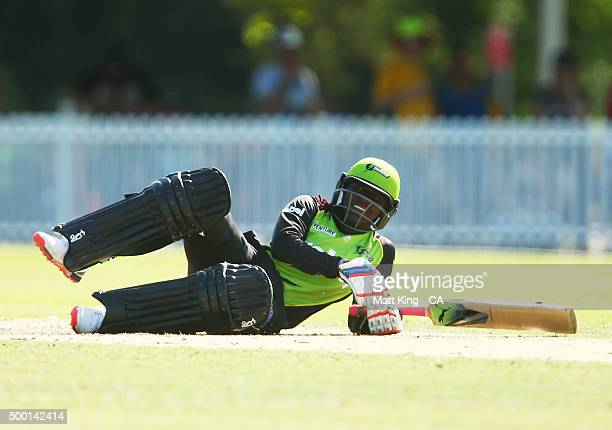 Stafanie Taylor of the Thunder falls down while batting during the Women's Big Bash League match between the Sydney Thunder and the Sydney Sixers at...