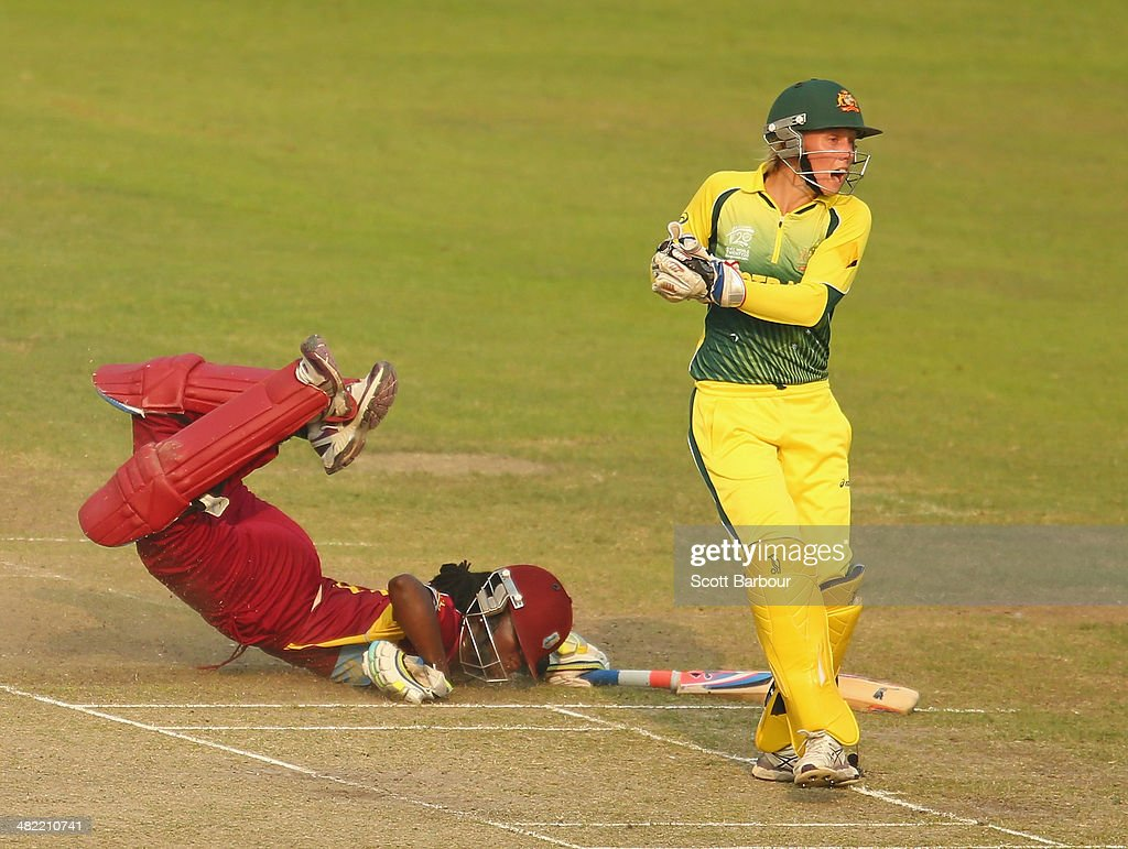 Stafanie Taylor of the West Indies dives but is run out by Alyssa Healy of Australia during the ICC Women's World Twenty20 Bangladesh 2014 1st Semi-Final match between Australia Women and West Indies Women at Sher-e-Bangla Mirpur Stadium on April 3, 2014 in Dhaka, Bangladesh.