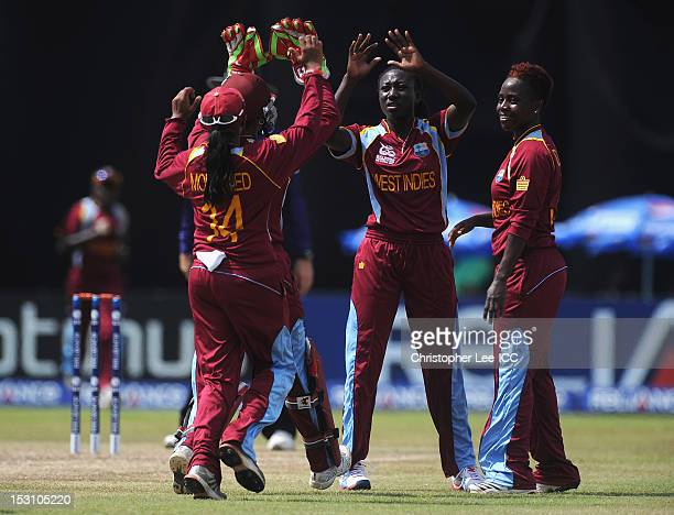 Stafanie Taylor of West Indies is congratulated after taking the wicket of Mignon Du Preez of South Africa during the ICC Women's World Twenty20 2012...