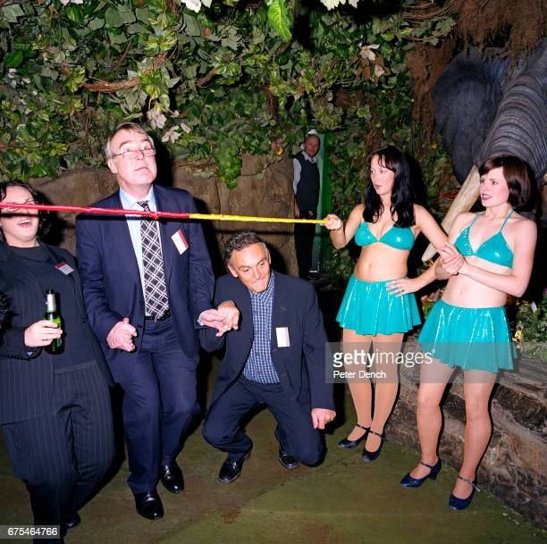 Staff and clients of Lawrence Graham a firm of solicitors join limbo dancers at the Rainforest Cafe London November 2002