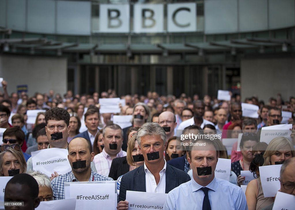 BBC staff and colleagues from other news organisations take part in a oneminute silent protest outside New Broadcasting House against the sevenyear...