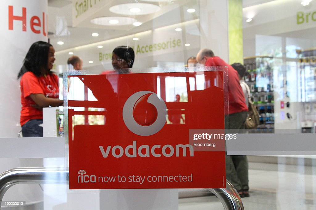 Staff and customers are seen inside a Vodacom store at Vodaworld, the headquarters of Vodacom Group Ltd., Vodafone's biggest African business, in Johannesburg, South Africa, on Monday, January 28, 2013. Almost two decades after Vodafone Group Plc entered Africa, the region -- where most people earn less than $2 a day and mobile phone towers run on diesel -- is turning into one of the company's biggest profit generators. Photographer: Nadine Hutton/Bloomberg via Getty Images