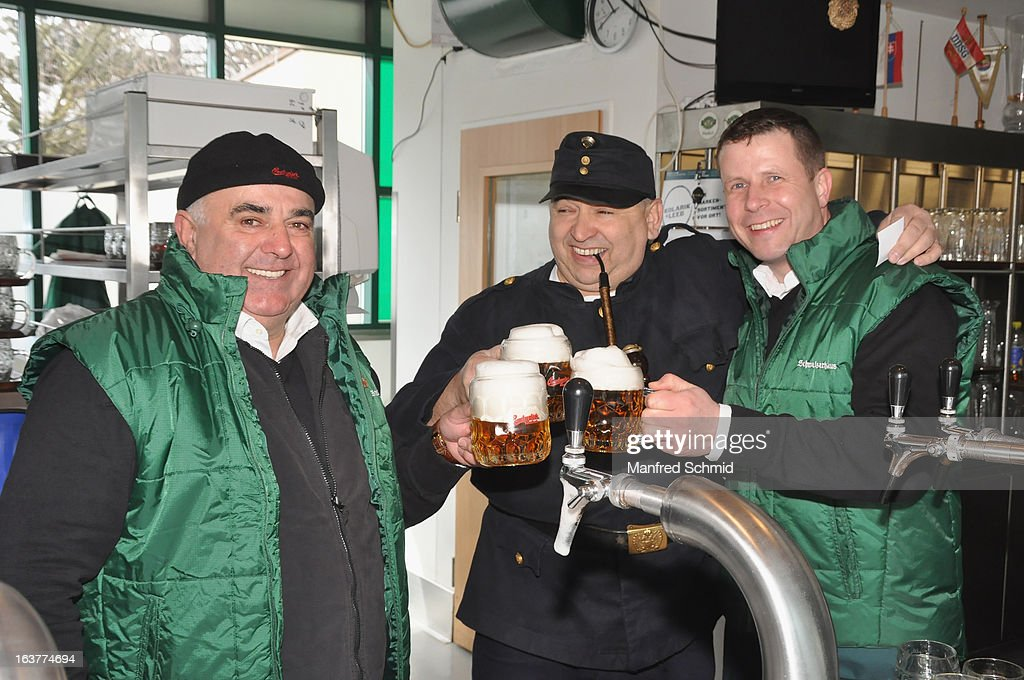 A Staff and 'Soldat Schwejk' during the opening of Schweizerhaus Wien on March 15, 2013 in Vienna, Austria.