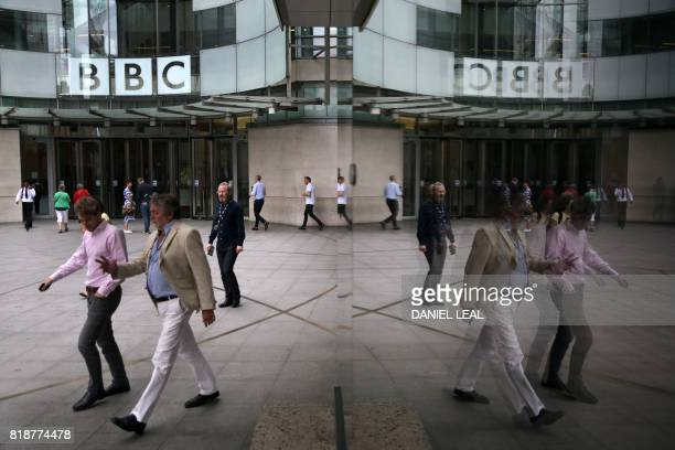 Staff and visitors walk outside the headquarters of the British Broadcasting Corporation in central London on July 19 2017 Britain's public...