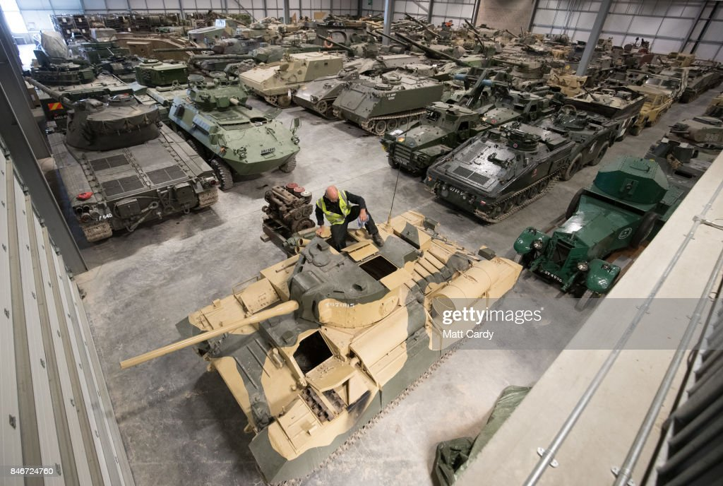 Staff and volunteers help prepare tanks stored at the Vehicle Conservation Centre at the Bovington Tank Museum for this weekend's Tiger Day, which will feature a Tiger tank, the only working example in the world, being demonstrated to the public, on September 13, 2017 in Dorset, England. Bovington The Tank Museum is home to Tiger 131, which was captured intact by the allies during fierce fighting in the Tunisian desert in 1943 and is currently part of a world-first exhibition, The Tiger Collection, which showcases the entire Tiger family side-by-side. Such was the importance of its capture that Prime Minister Winston Churchill and King George VI went to North Africa be pictured with it.
