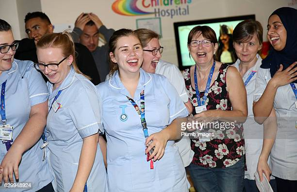 Staff are all smiles during the Leicester City Players Deliver Christmas Presents to Patients at Leicester Royal Infirmary on December 15 2016 in...