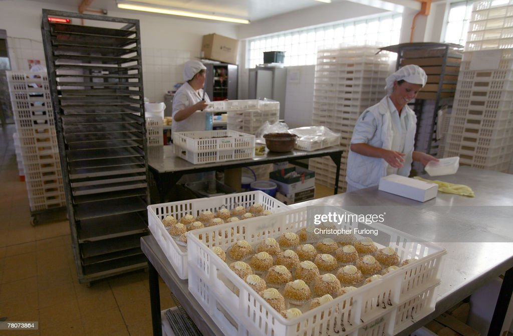 Staff at Master baker John Pimblett's bakery prepare confectionery in readiness for Christmas their bakery in St Helens, England on November 12, 2007. John Pimblett's bakery has been busy making it's speciality Christmas puddings in time for the seasonal rush. John is the third generation baker since 1921 who have been making cakes and pies in the merseyside bakery. Pimblett's award winning Christmas puddings are made in the traditional way but with a few secret ingredients says John. Pimblett's Christmas puddings can be found in all the best delicatessens around Britain and abroad.