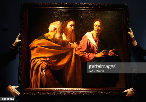 Staff at The Queen's Gallery at the Palace of Holyrood maneuver The Calling of Saints Peter and Andrew by Caravaggio on November 12 2008 in Edinburgh...