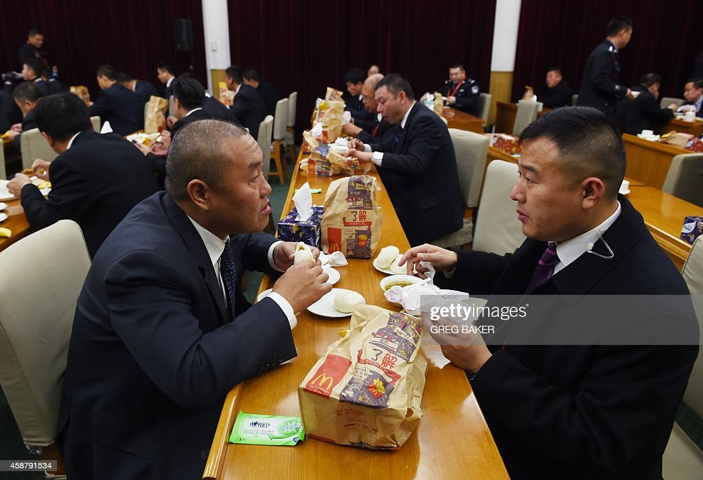 Staff at the Zhongnanhai leadership compound eat a mixture of McDonalds and dumplings while US President Barack Obama has a private dinner with...