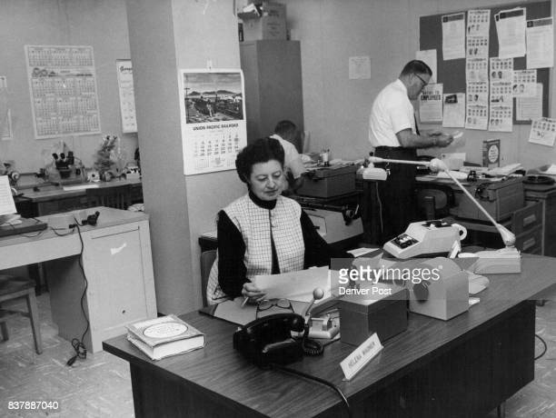 Staff at work in offices in state services building Receptionist is Mrs Helena Wagner Working in background are agents Wil­liam McCord left and...