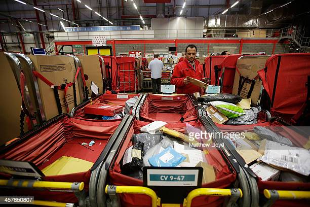 Staff at work in the packet and parcel section of the Royal Mail's Swan Valley mail centre on December 18 2013 in Northampton England This Friday the...