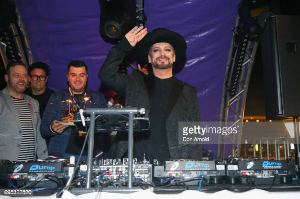 Staff bring out a birthday cake as Boy George plays as DJ Set For VIVID Music at Cafe Del Mar on June 12 2017 in Sydney Australia