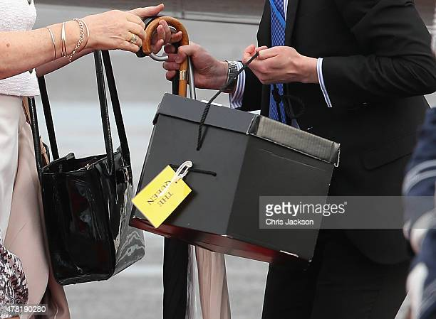 Staff carry luggage off the plane as Queen Elizabeth II and Prince Philip Duke of Edinburgh arrive at Berlin Tegel Airport for a four day State Visit...