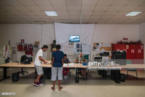 Staff check the details of an asylum seeker and then they give them their daily money allowance on July 27 2017 in Bologna Italy In an effort to...