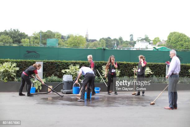 Staff cleaning outside Center Court during the Wimbledon Lawn Tennis Championships at the All England Lawn Tennis and Croquet Club at Wimbledon on...
