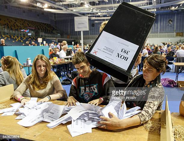 Staff count ballot papers at the Glasgow count centre at the Emirates Arena Glasgow Scotland on June 23 2016 after polls closed in the referendum on...