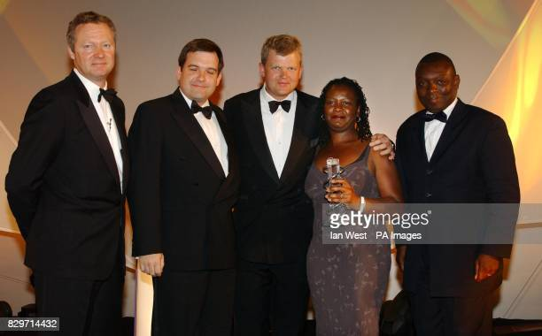 Staff from Aspect Television Ltd receive the TV Factual Award for 'What Ron Said' presented by Rory Bremner Adrian Chiles and Garth Crooks