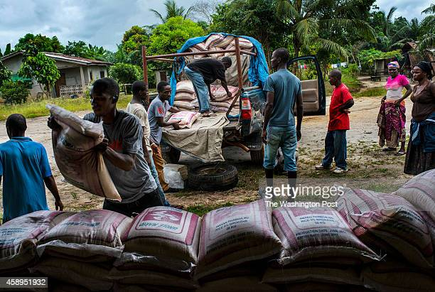 LIBERIANOVEMBER 5 Staff from Orphan Aid Liberia unload a truck of food and supplies for families affected by Ebola on Friday November 5 2014 in...