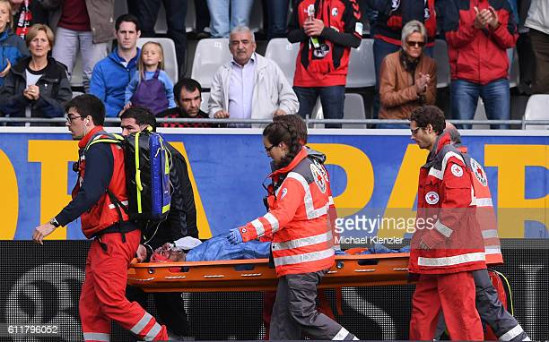 Staff from Red Cross carry injured player Onur Bulut of SC Freiburg off the pitch during the Bundesliga match between Sport Club Freiburg and...