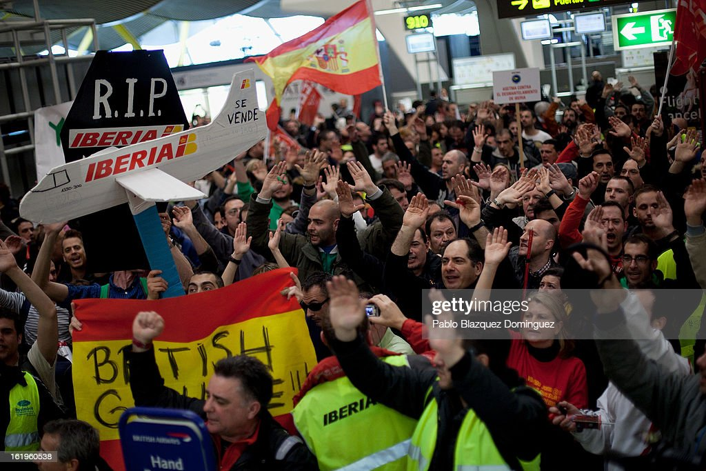 Staff from Spanish Airline Iberia hold signs and gather in protest against job cuts at Barajas Airport on February 18, 2013 in Madrid, Spain. Today is the first of a five day strike held by Iberia cabin crew, maintenance workers and ground staff in response to the planned loss of 3,800 jobs. The strike has resulted in the airline having to cancel 400 flights this week with unions planning a further five day strikes within a month.
