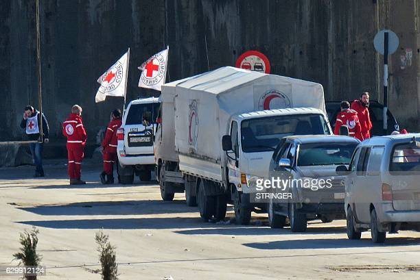 Staff from the International Red Cross and from the Syrian Red Crescent are seen in embattled city of Aleppo as efforts were underway to evacuate...