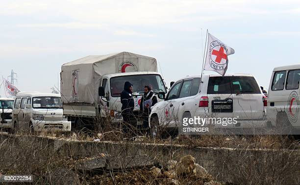 Staff from the International Red Cross and from the Syrian Red Crescent are seen as civilians and fighters are evacuated from a rebelheld area of...