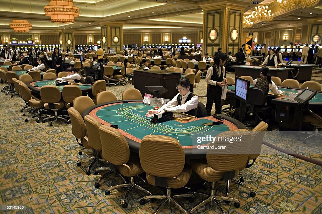 Staff get ready at the opening of the Venetian casino in Macau