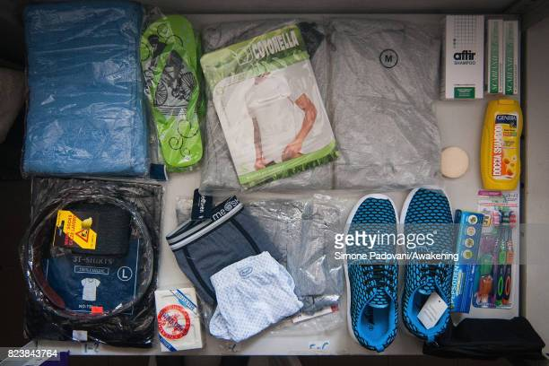 Staff give newlyarrived asylum seekers basic kits for men women and children for their short stay at the Hub Cara center where they are able to...