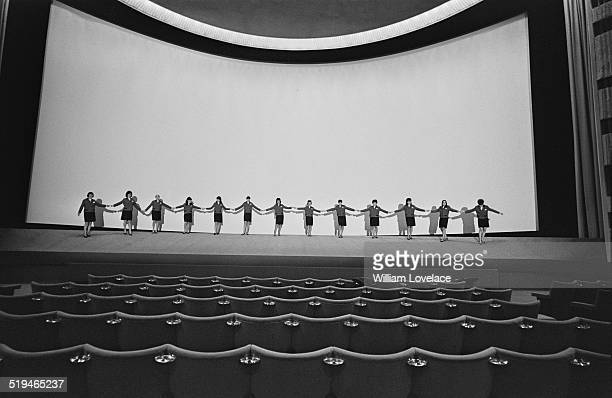 Staff holding hands in front of the screen at the Odeon cinema at Marble Arch London 28th January 1967
