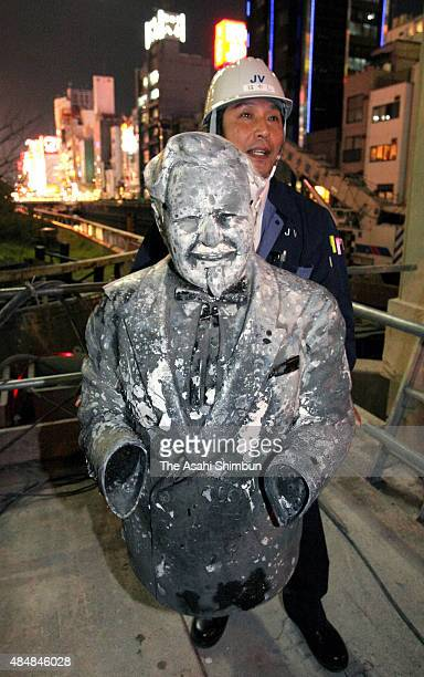 A staff holds a upper part of statue Colonel Sanders which was thrown into the river when Hanshin Tigers won the Central League season champion in...