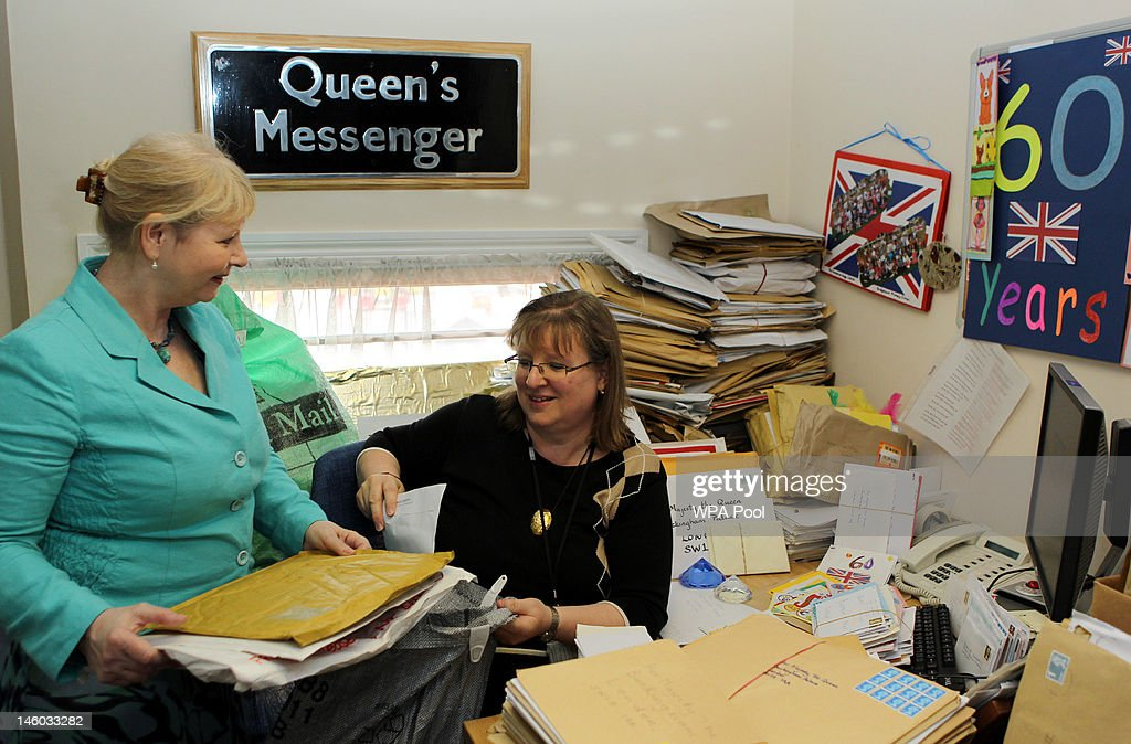 Staff (names not given) in the Correspondence Office at Buckingham Palace, London with letters sent to Queen Elizabeth II for her Diamond Jubilee on June 8, 2012 in London, England.